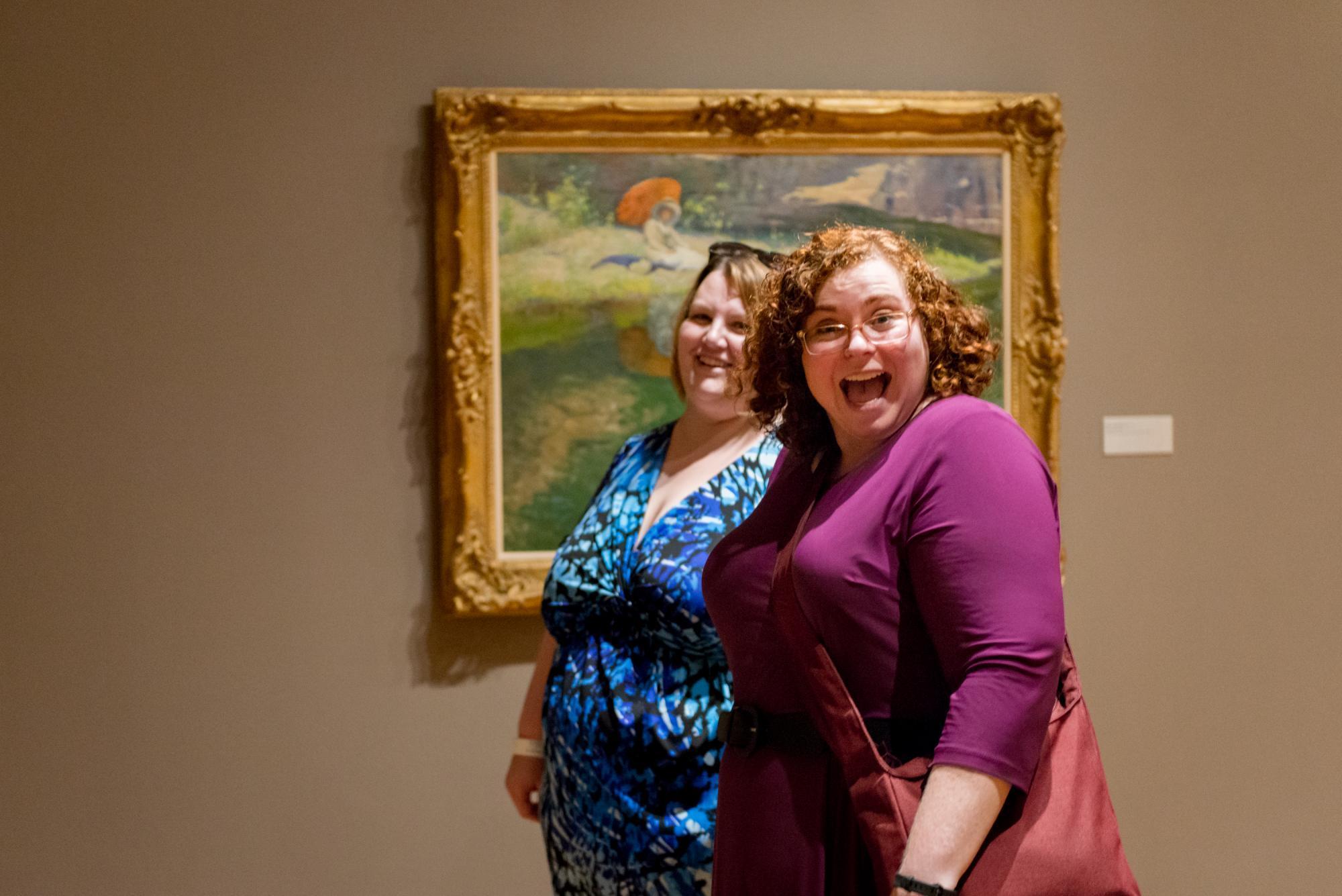 Friends viewing art