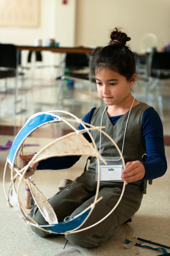 A child creates her sculpture