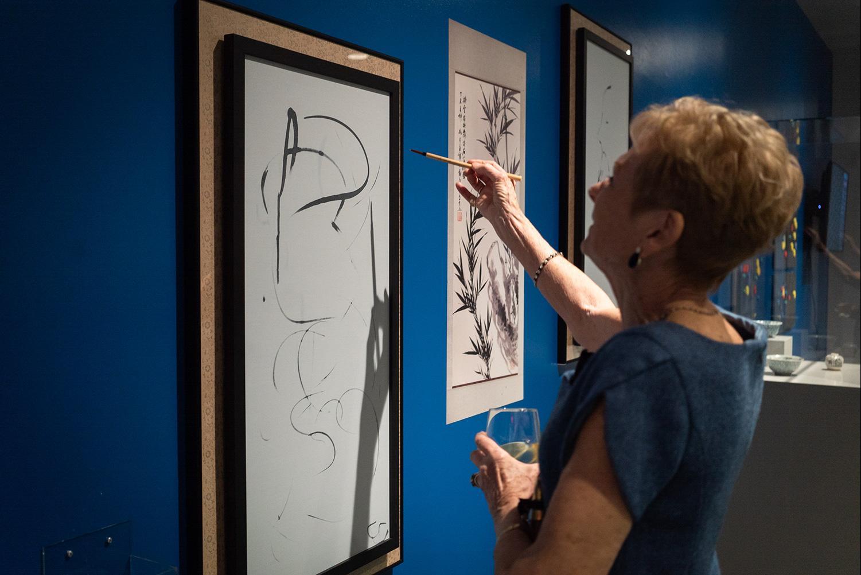 Woman Painting on Buddha Board